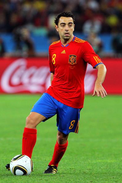 Xavi-playing-for-Spain-xavi-hernandez-16584193-396-594.jpg
