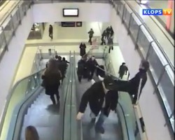 Kid horsing around on escalator takes nasty fall