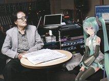 初音ミクと打ち合わせする冨田先生(DENON )