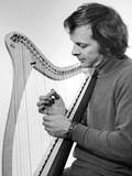 Young Hogwood playing an early harp