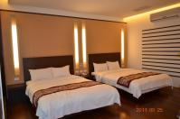 怡園渡假村典雅4人房のベッド